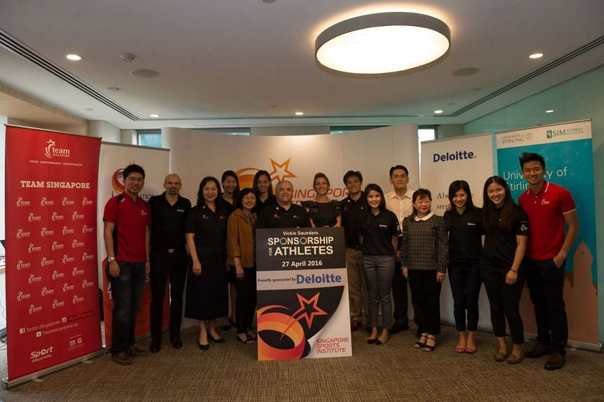 Group photo of athletes, members of the Singapore Sports Institute and consulting company Deloitte at the book launch, on April 27, 2016.