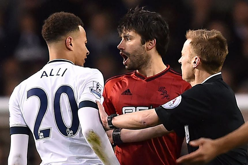 Tottenham midfielder Dele Alli exchanges angry words with West Brom's Claudio Yacob. The Spurs player was caught punching Yakob in an off-the-ball incident and may miss the rest of the season.