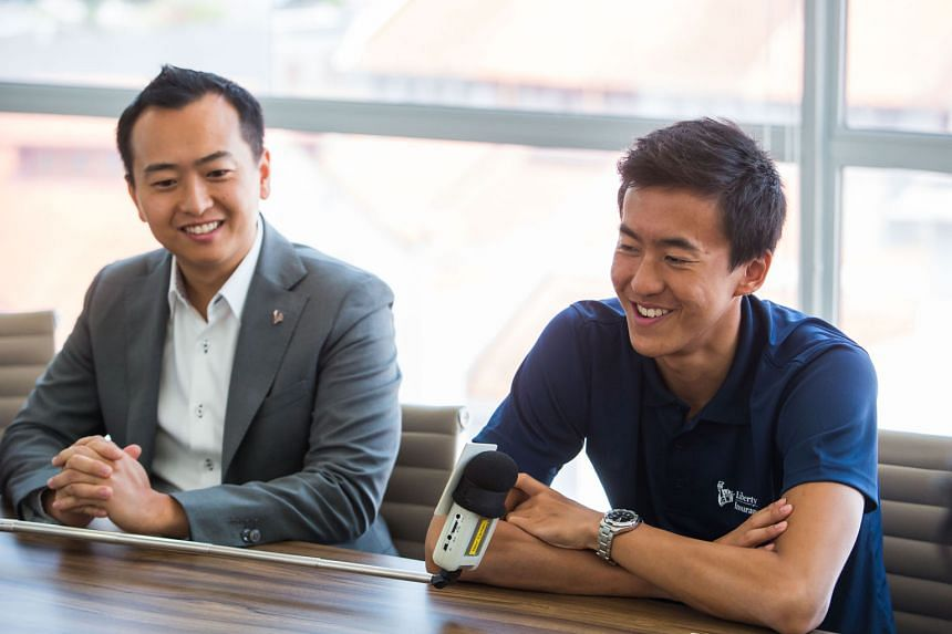 CEO of Liberty Insurance Singapore Chang Sucheng (left) and national swimmer Quah Zheng Wen at the launch of the company's branding campaign yesterday. Quah, 19, is their new local brand ambassador.