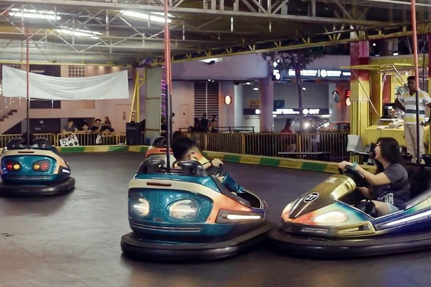 """One of the attractions is The Balloon Wheel (left), which resembles a Ferris wheel, where children ride in """"hot-air balloons"""". There are also bumper cars (right) which offer thrills for the young and young at heart."""