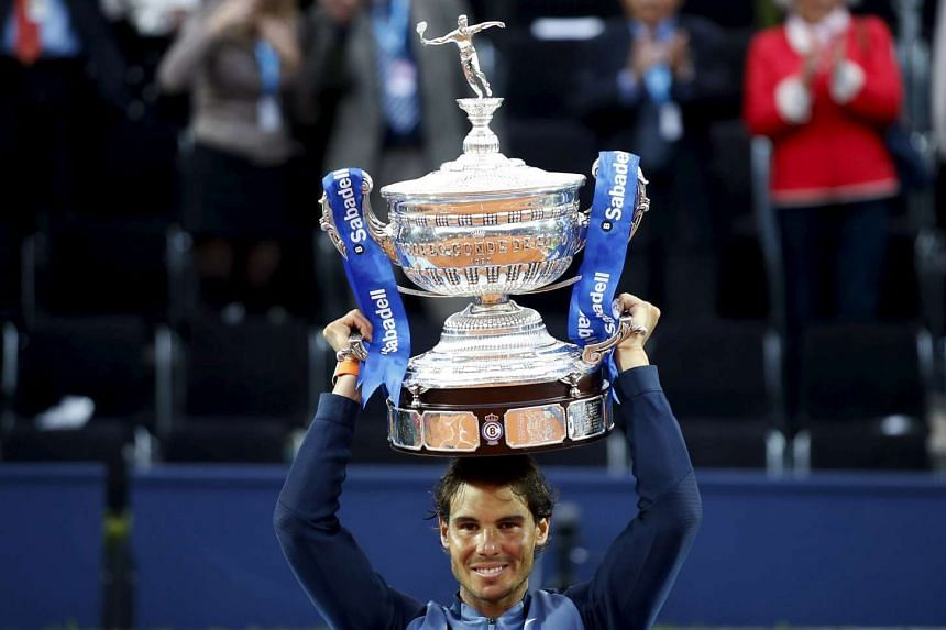 Rafael Nadal of Spain raises up the Barcelona Open trophy after defeating Kei Nishikori of Japan in Barcelona, Spain on April 24. He will carry the Spanish flag at the Olympic Games in Rio de Janeiro.