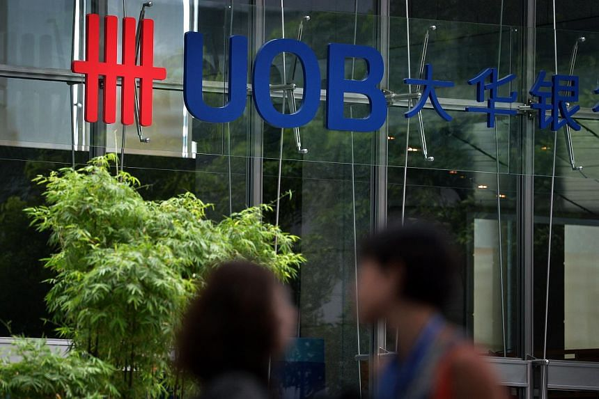 Office workers walking in front of the UOB Centre located along Robinson Road at Raffles Place.