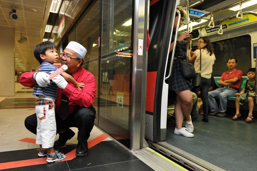 """MRT Uncle"" Zainodin Bin Abdul Hadi, 65, Service Ambassador, and Mr Jovan Phang, 4, at Bishan MRT station on April 29 2016."