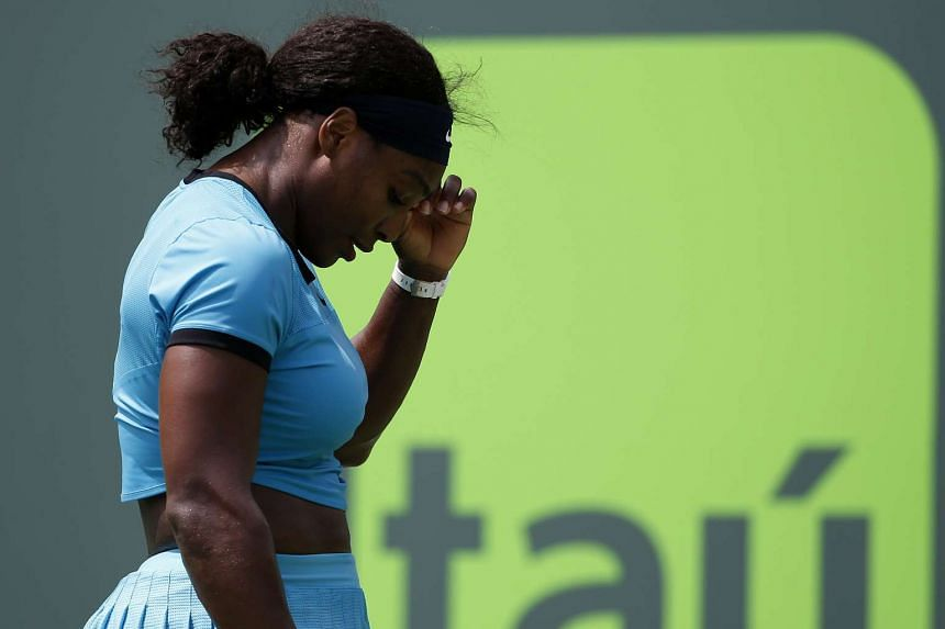 Serena Williams reacts after missing a shot against Svetlana Kuznetsova on day seven of the Miami Open, on March 28, 2016.