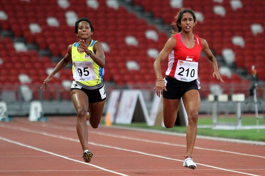 Shanti Pereira (right) finished second in the women's 100m sprint at the 78th Singapore Open Track and Field Championships, on April 28, 2016.