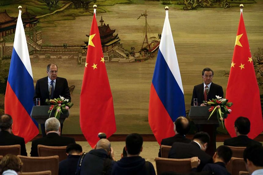 Russian Foreign Minister Sergei Lavrov (left) and his Chinese counterpart Wang Yi (right) hold a joint press conference at the Foreign Affairs Ministry in Beijing on April 29, 2016.
