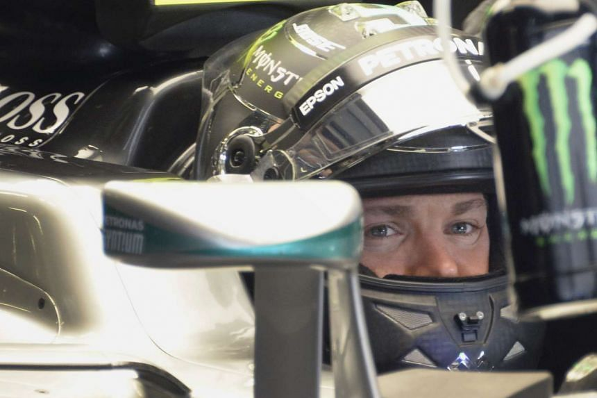 Nico Rosberg sits in his car during the first practice session of the Formula One Russian Grand Prix at the Sochi Autodrom circuit on April 29, 2016.