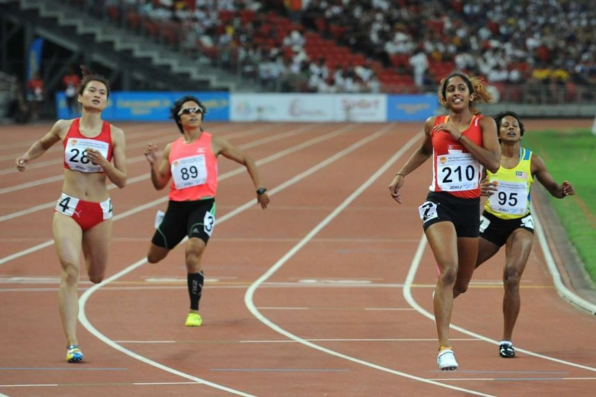 Shanti Pereira (second from right) strode to victory in the women's 200m sprint at the Singapore Open Track and Field Championships, on April 29, 2016.