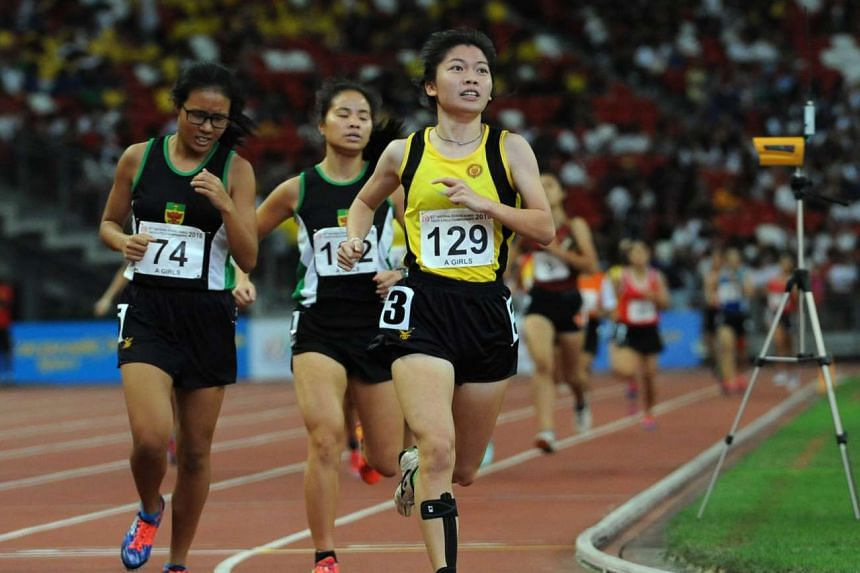 VJC's Alexandra Wee (right), ahead of Corrie Teo (left) and Natalie Seoh (centre), both of Raffles Institution, during the A Division girls' 800m final.