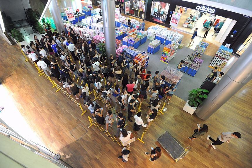 People queuing to buy cheese tarts on the opening day of Bake Cheese Tarts at Ion Orchard on Friday (April 29) morning.