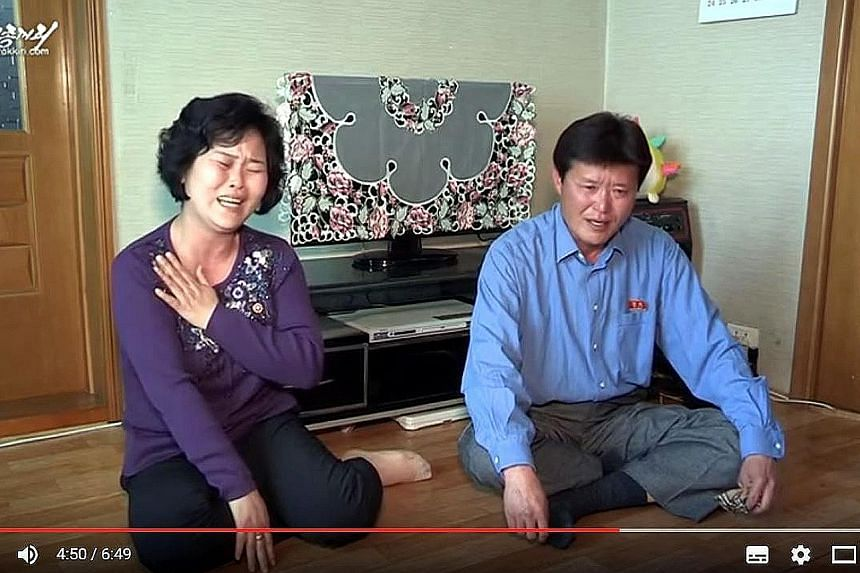 A screengrab of a video showing the parents of waitress So Gyong A. Pyongyang claims Ms So and 11 other waitresses were tricked into defecting when they went to work at a restaurant in China.