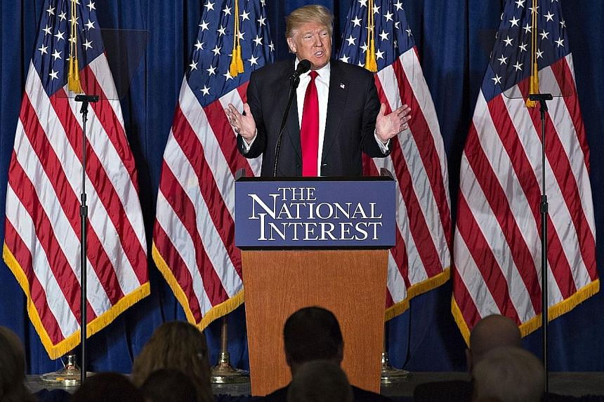 """Mr Trump speaking at the Mayflower Hotel in Washington DC on Wednesday. Experts and politicians say his speech on an """"America first"""" foreign policy contains many inconsistencies and oversimplify global affairs as well as sends mixed messages to US al"""