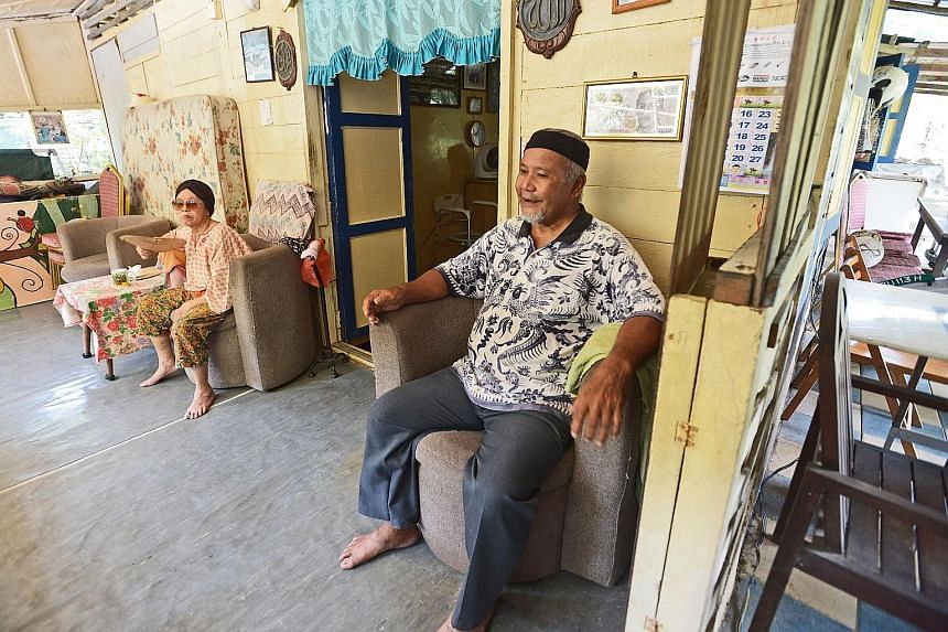 Mr Ahmad and his wife Sapiah Taib, 78, in their kampung house on Pulau Ubin. His expertise in building and repairing kampung houses and digging wells was uncovered and recorded by anthropologist Vivienne Wee and her research team as part of the first