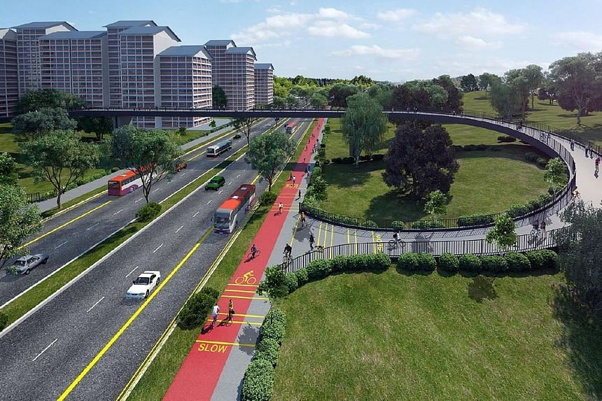 Artist's impression of the Marymount Road section of the North-South Corridor, Singapore's first integrated transport corridor that will have dedicated bus lanes and a cycling route. It will link towns in the north to the city. Major construction wor