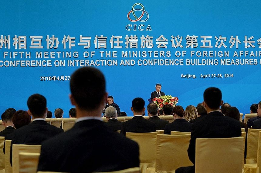 President Xi speaking at the opening ceremony of the foreign ministers' meeting of the Conference on Interaction and Confidence Building Measures in Asia (Cica) at the Diaoyutai State Guesthouse in Beijing yesterday.