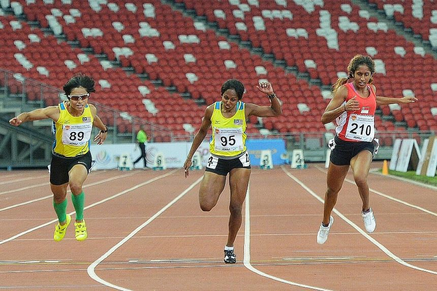 National sprinter Shanti Pereira (right) wins silver in 11.84sec at the Singapore Open Track and Field Championships. Malaysia's Komalam Selvaretnam (centre) clinched gold.
