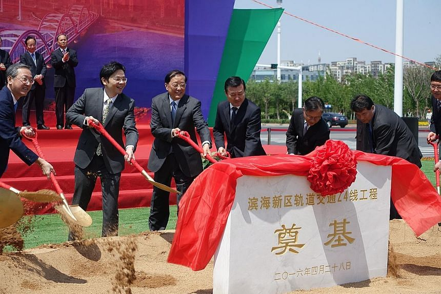 Mr Wong (left) and Mr Chen (second from left) taking part in the ground- breaking ceremony for the new line at the Sino- Singapore Tianjin Eco-city yesterday.