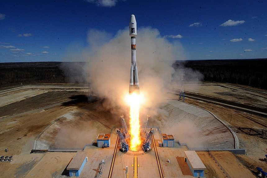 A Russian Soyuz 2.1a rocket carrying three satellites lifting off yesterday morning from the new cosmodrome outside Uglegorsk city in the far eastern Amur region.