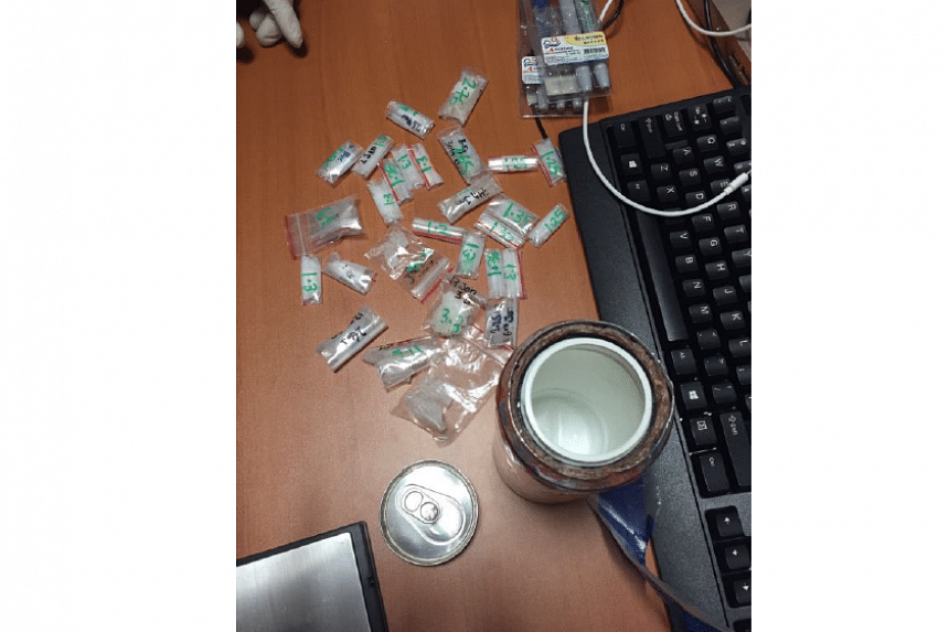 The modified interior of another one of the metal cans used to conceal drugs and small packets of drugs, found in a unit in Tampines during a CNB operation on April 26, 2016.