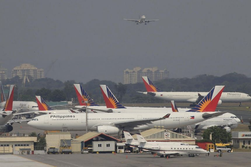A Philippines Airlines aircraft parking beside a hangar at a runway of the Ninoy Aquino International Airport in Manila on March 14, 2016.