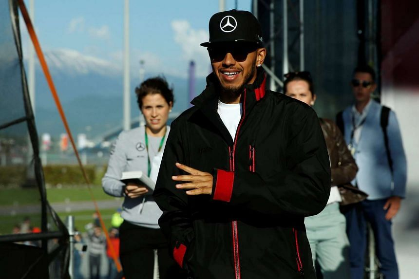 Lewis Hamilton arrives at an autograph session in Sochi.