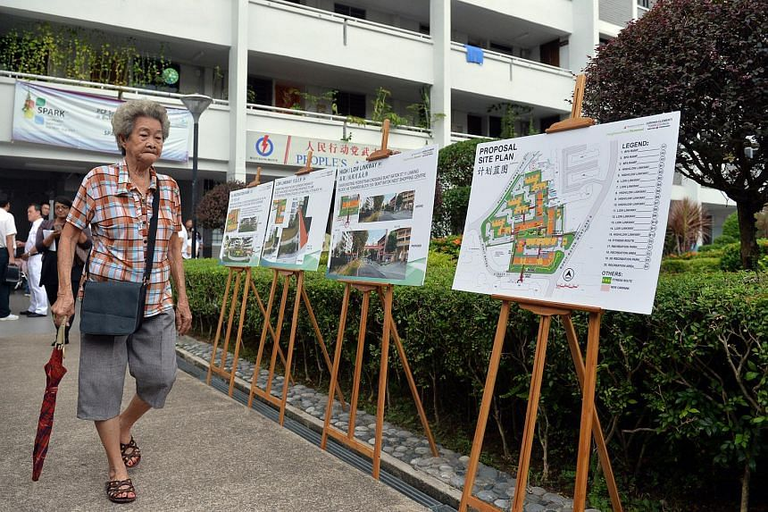 Details of the Neighbourhood Renewal Programme for Bukit Batok being put up for residents to view during the walkabout of Mr Murali Pillai.