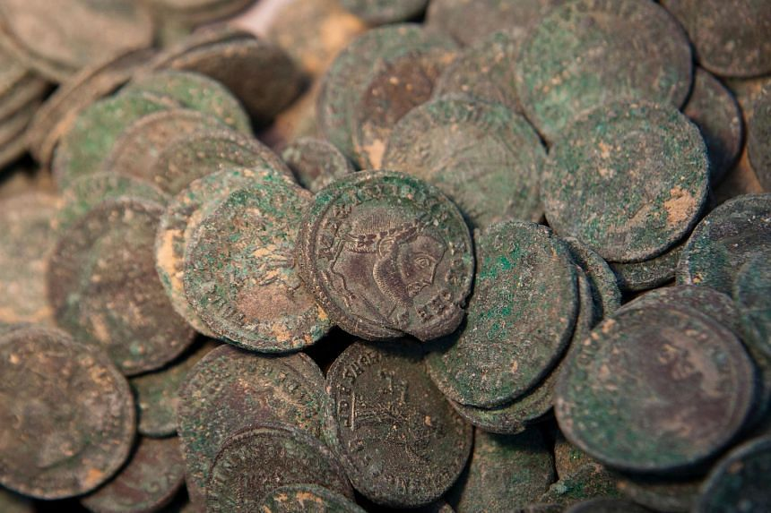 Roman era bronze coins are displayed at Seville's Archeology Museum on April 28