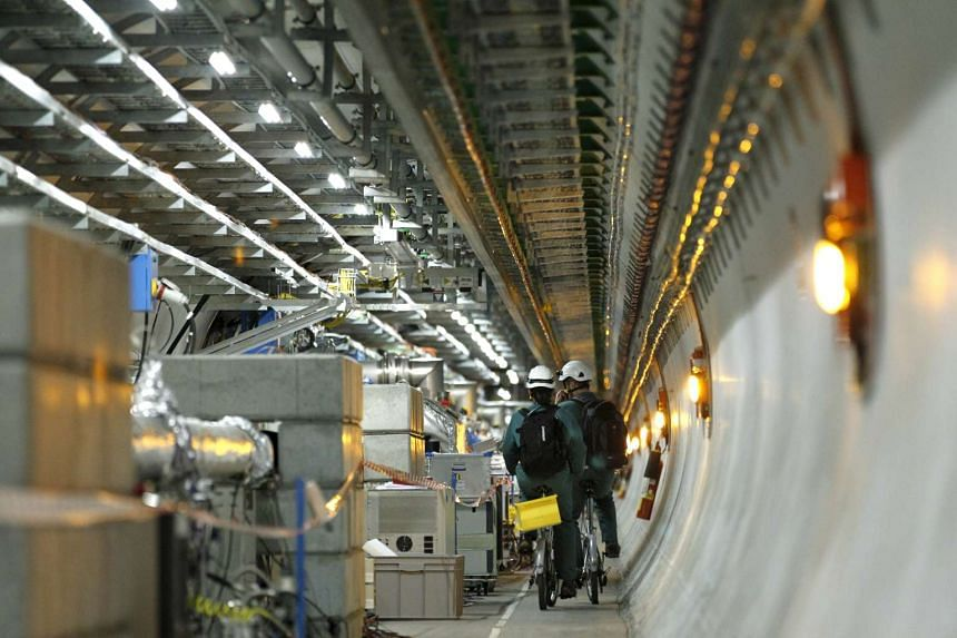 Technicians riding bikes in the tunnel of the large hadron collider on Feb 16, 2016.