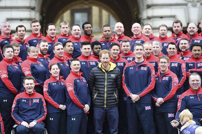 Britain's Prince Harry poses for a photo with members of Great Britain's Invictus Games team at Buckingham Palace in London, on April 6, 2016.