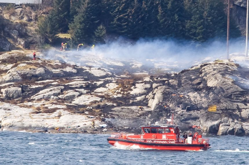 Rescue forces work at the shore west of Bergen, Norway after a helicopter transporting 13 workers from an offshore oil field in the North Sea crashed on April 29, 2016.