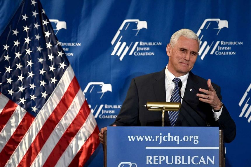 Indiana Gov. Mike Pence gestures during the Republican Jewish Coalition Spring Leadership Meeting in Las Vegas, Nevada, US, on April 25, 2015.
