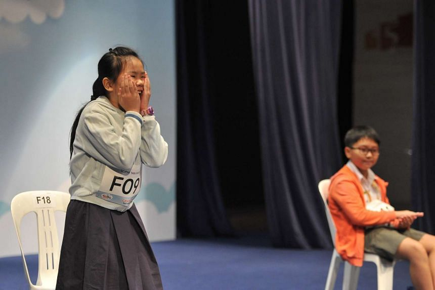 Sophi Tan Xuan (left), from Raffles Girls' Primary School, won the RHB-The Straits Times National Spelling Championship.