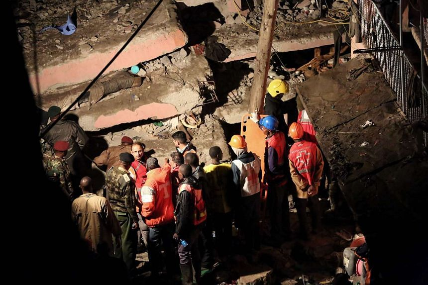 Emergency personnel looking for survivors trapped under the rubble of a building that collapsed in Nairobi on Friday, April 29, 2016.