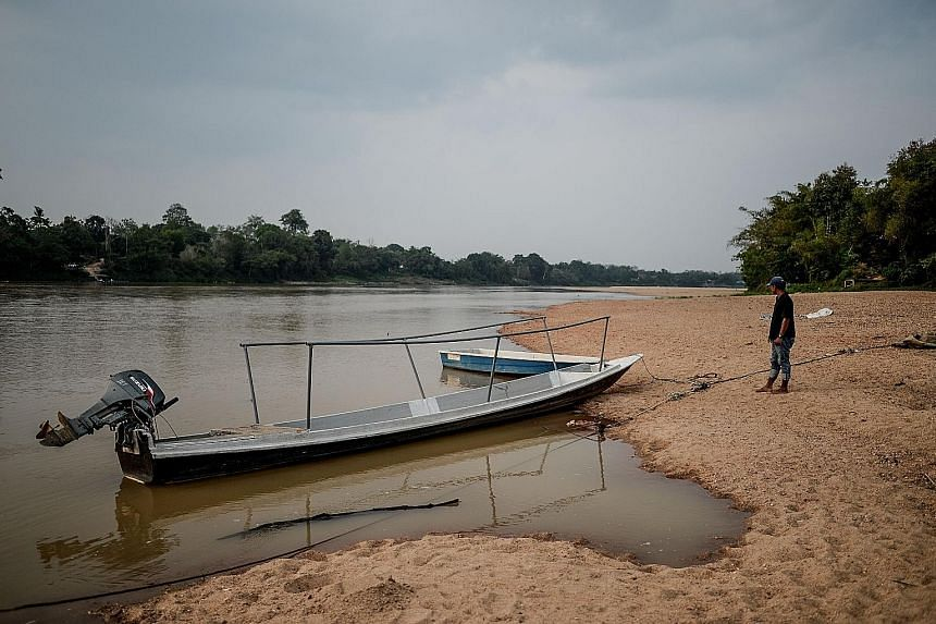 The Pahang River has shrunk to a third its normal size in the heatwave that has ravaged much of Asia. El Nino has shrunk reservoirs, dried up agricultural lands, forced water rationing in some areas and caused repeated school closures as a health pre