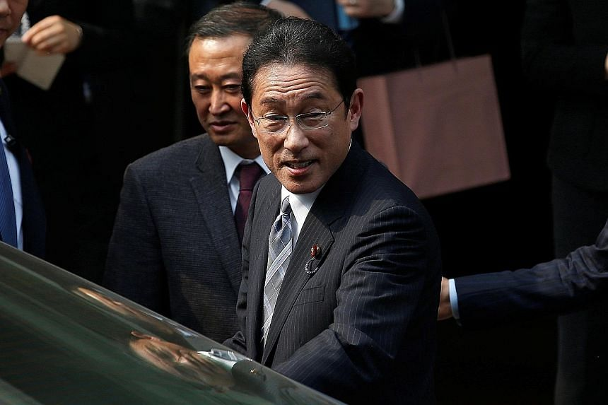 Mr Kishida leaving Hiroshima University's Beijing Research Centre at Capital Normal University in Beijing after a visit yesterday. He is reportedly seeking to make preparations for a summit between Japanese Premier Shinzo Abe and Chinese President Xi