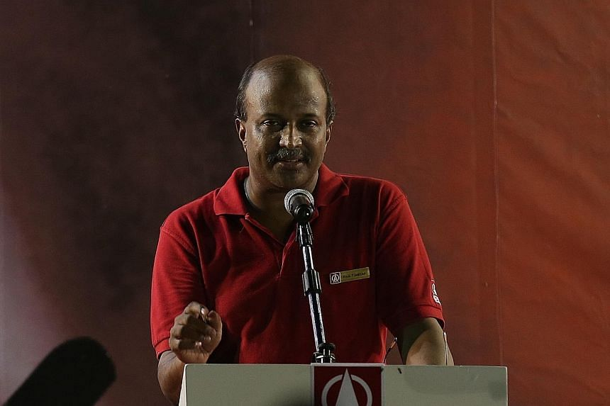 Speaking at the SDP rally yesterday, Dr Tambyah (left) said Dr Chee will be a fresh voice in Parliament if elected and won't be afraid to speak up, while Mr Sadasivam (above) said former MP David Ong had broken his promise to residents.