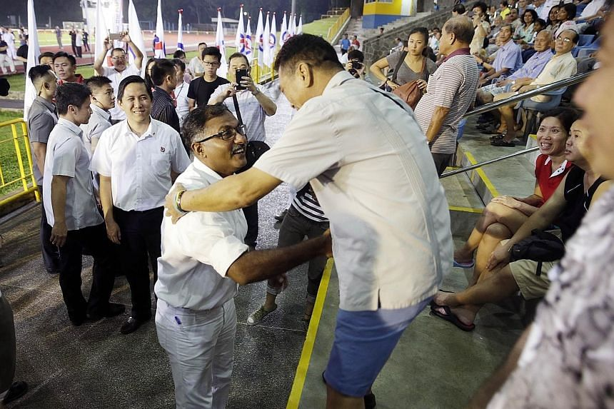 (Below) Mr Murali greeting people attending the PAP rally at Bukit Gombak Stadium last night. As the PAP's candidate for the single seat, he said he will have the support of the party's Jurong GRC MPs if he is elected. Mr Murali speaking at his first