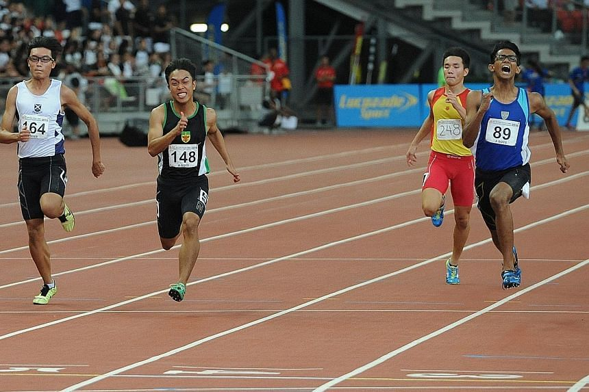 Shahmee Ruzain of Catholic Junior College (right) winning the A Division 100m yesterday. He won the 200m gold on Monday and helped CJC to a silver medal in the 4x100m relay.