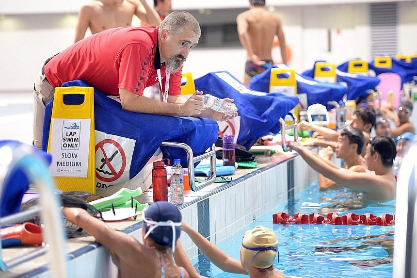 National swimming coach Sergio Lopez conducting his first training session at the OCBC Aquatic Centre in January last year. Under his guidance, Singapore won a record 23 gold medals at last year's SEA Games.