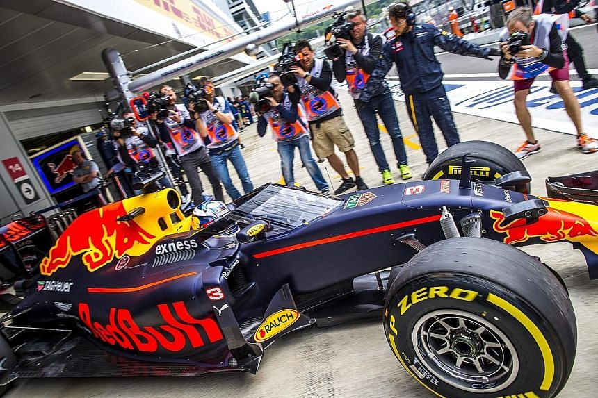 """Daniel Ricciardo driving his Red Bull out of the pits to test the new cockpit canopy during the first practice session at the Sochi Autodrom circuit in Russia. """"The first impression seems okay,"""" the Australian said. """"It doesn't really block any more"""
