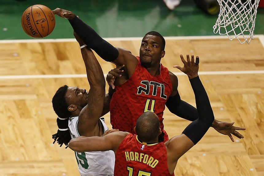 Paul Millsap (No. 4) of the Atlanta Hawks blocks a shot from Jae Crowder of the Boston Celtics during the 104-92 victory to eliminate their opponents in Game Six of the Eastern Conference quarter-finals on Thursday.