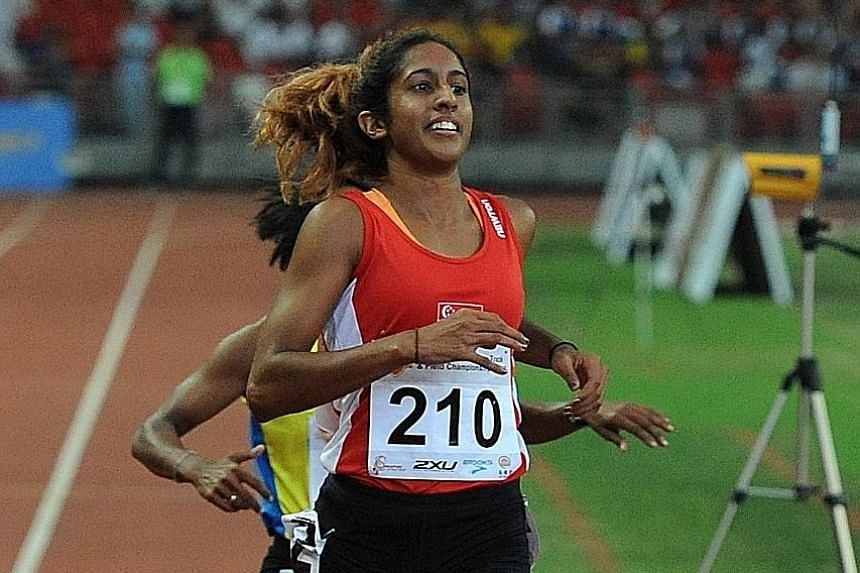Shanti Pereira running in the women's 200m final in the 78th Singapore Open at the National Stadium yesterday. She clinched her first gold of the meet with a time of 24.04sec.