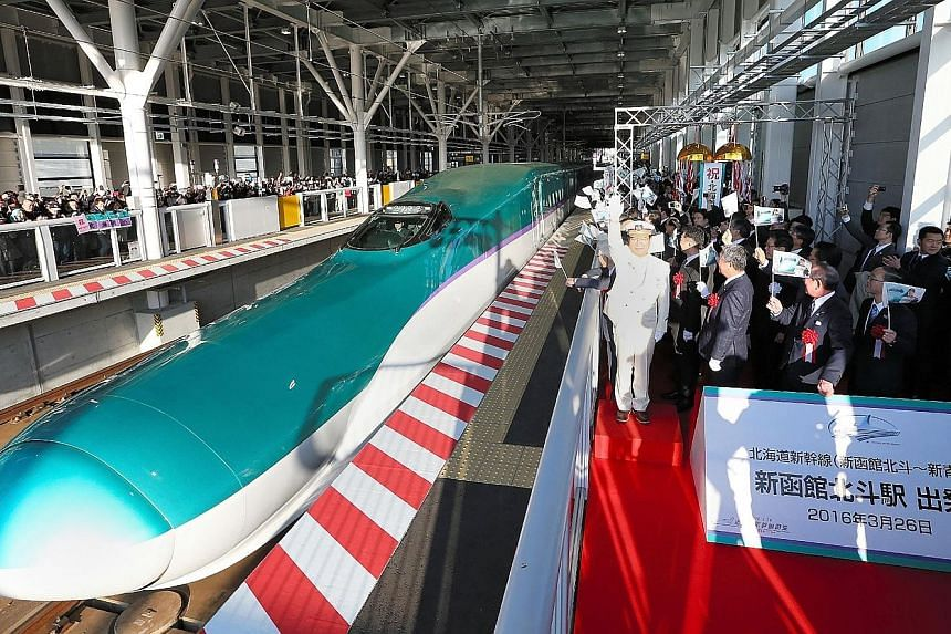 Hokkaido celebrating the departure of its first shinkansen bullet train on March 26. Japan's shinkansen technology boasts zero deaths in its 51-year history.