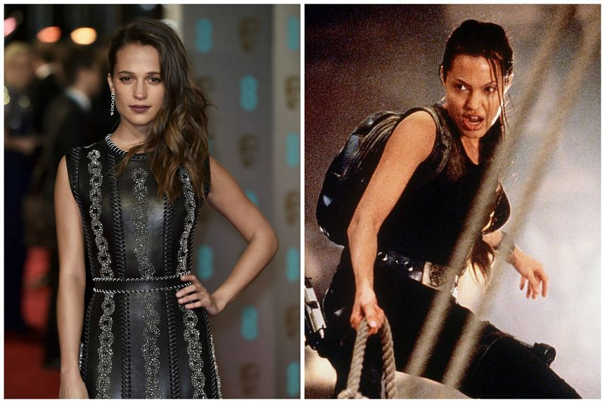 Alicia Vikander (left) is reportedly taking on the role of young Lara Croft in an origin film. The role was played by Angelina Jolie (above) twice.