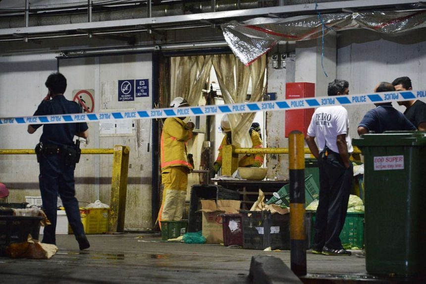 Police and Singapore Civil Defence Force officers at the Pasir Panjang Wholesale Centre where there was an ammonia gas leak.