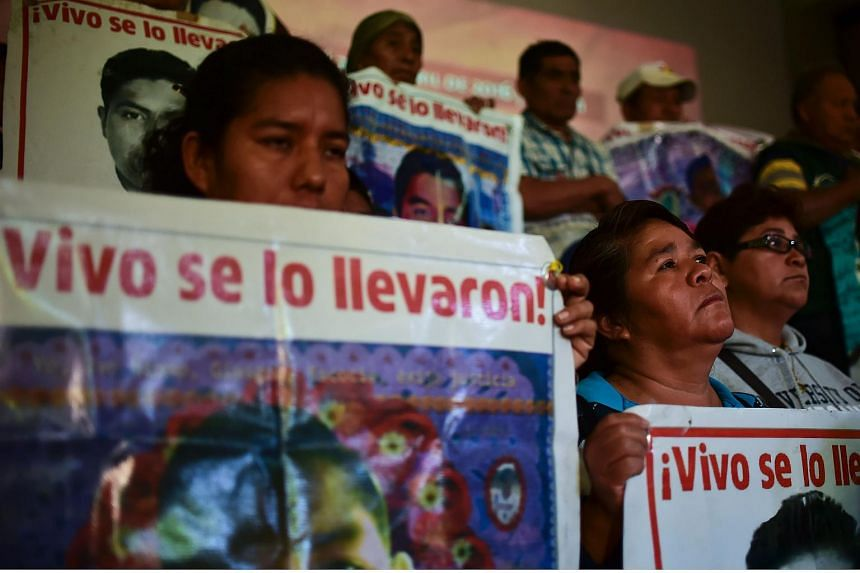 Relatives of the 43 missing students are pictured during a press conference in Mexico City, on April, 25, 2016.