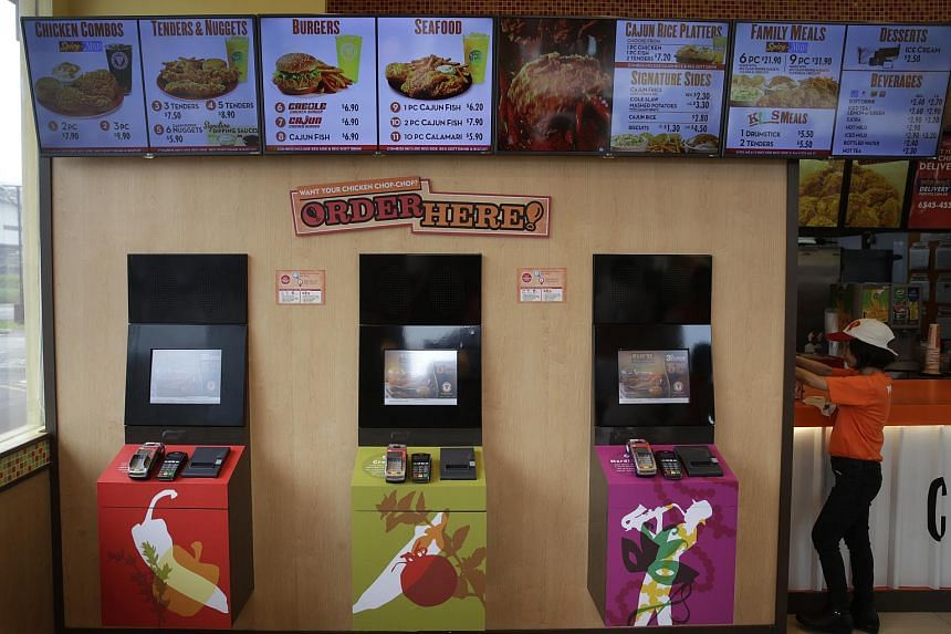 Self-ordering kiosks at Popeyes' Punggol East outlet.