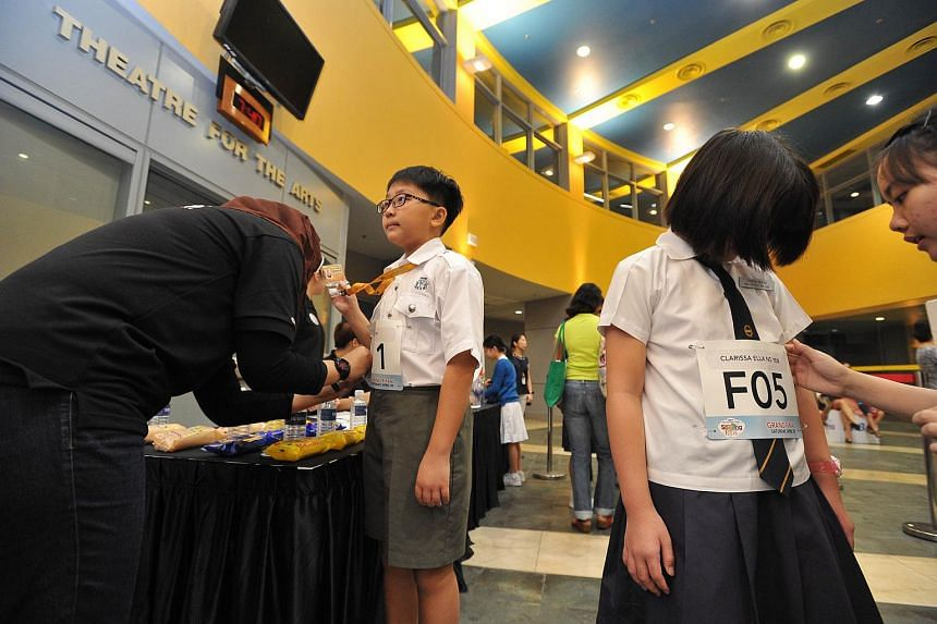 Participants registering before the start of the RHB-The Straits Times National Spelling Championship finals.