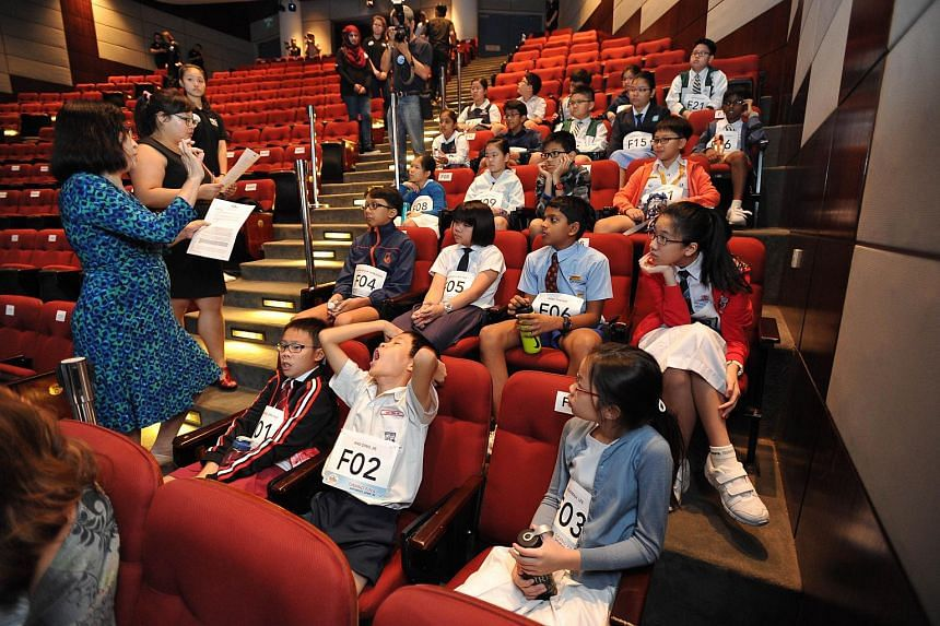 Participants listening to instructions from the officials before the start of the RHB-The Straits Times National Spelling Championship finals.