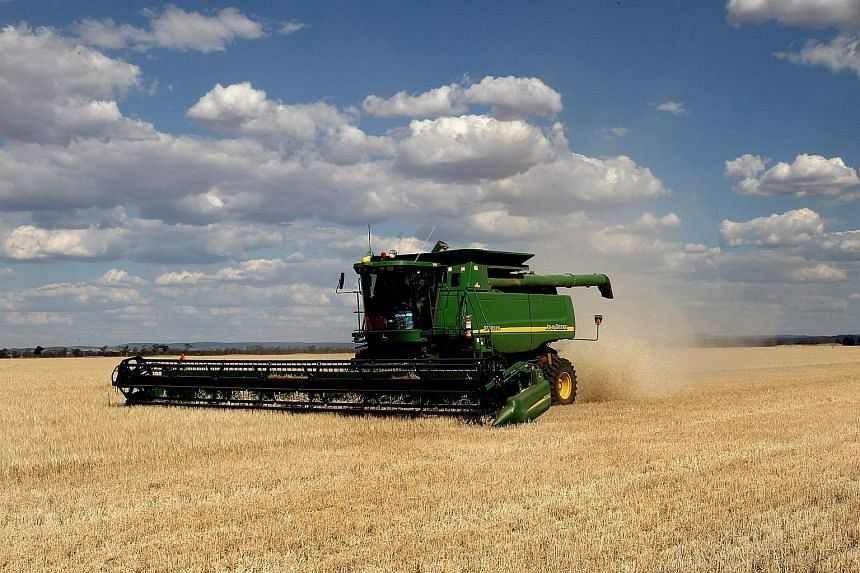 A barley crop being harvested on a farm in the central west of New South Wales. Australia is set to block the A$371 million (S$380 million) sale of the country's biggest private landholding to a Chinese consortium.